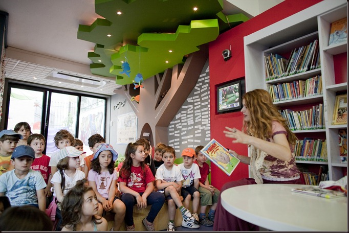 Children participate in group activities at the Veria Central Public Library in Veria, Greece on June 9, 2010. The library is a resource for 180,000 residents over three counties. The ground floor of the central library has been technology enhanced with a strong focus on engaging children in interactive and collaborative experiences. It is equipped with books, internet access, Nintendo Wii, music cd's and dvd's.