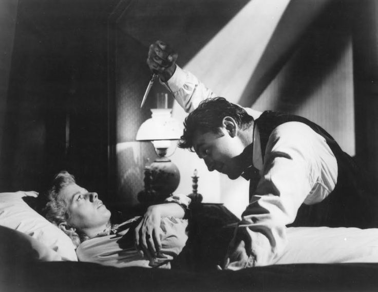 """Actors Robert Mitchum and Shelley Winters perform in a scene from """"The Night of the Hunter"""" in this undated photo released to the press on March 22, 2011. Stanley Cortez's cinematography in this sequence was greatly influenced by German expressionism. Source: Criterion Collection via Bloomberg EDITOR'S NOTE: NO SALES. EDITORIAL USE ONLY."""
